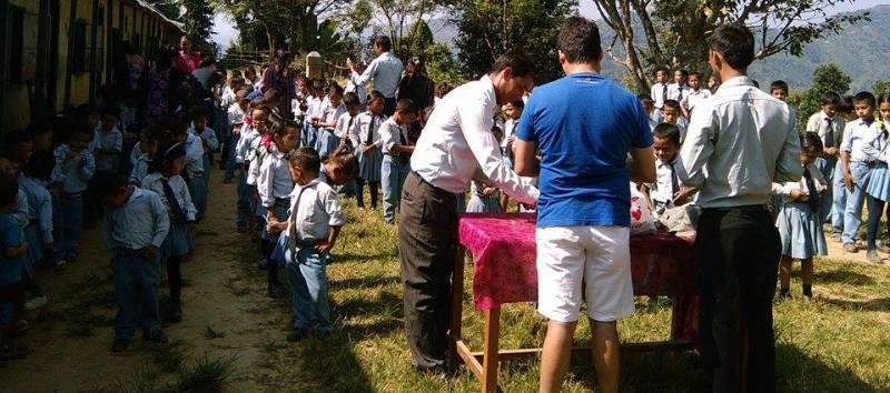 Providing some stationery to the students of Swornim Academy